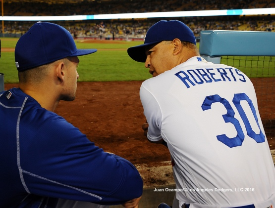 Dodgers manager Dave Roberts talks with Trayce Thompson.