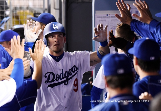 Yasmani Grandal high-fives his teammates in the dugout after his solo home run in the second inning.
