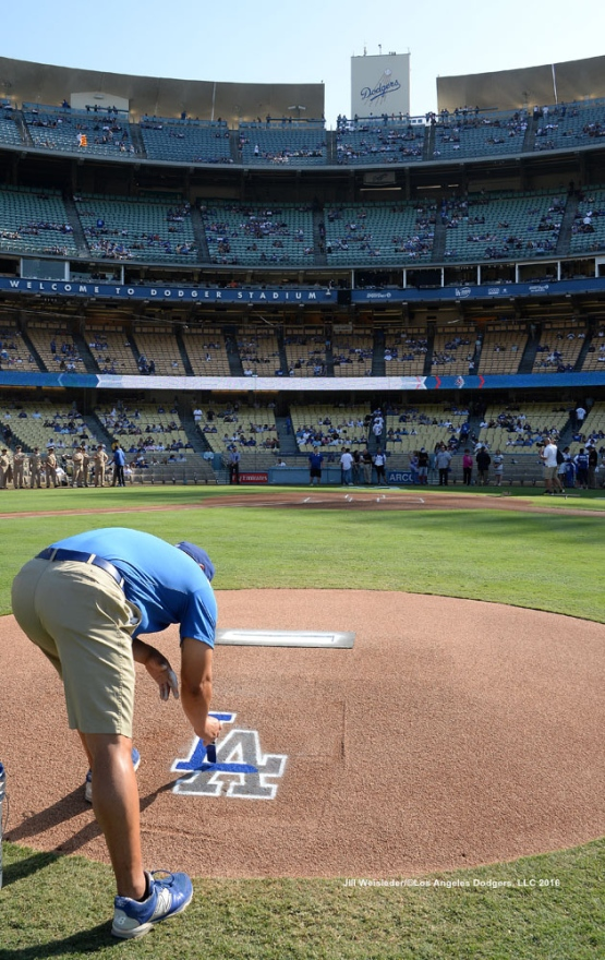 A grounds crew gets the mound ready for the game. Jill Weisleder/Dodgers