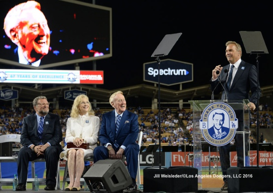 Actor Kevin Costner addresses the fans during the ceremony honoring Vin Scully. Jill Weisleder/Dodgers