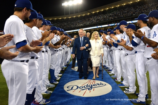 The Scullys' take the walk through the team during the Vin Scully Ceremony Friday, September 23, 2016 at Dodger Stadium. Photo by Jon SooHoo/©Los Angeles Dodgers,LLC 2016