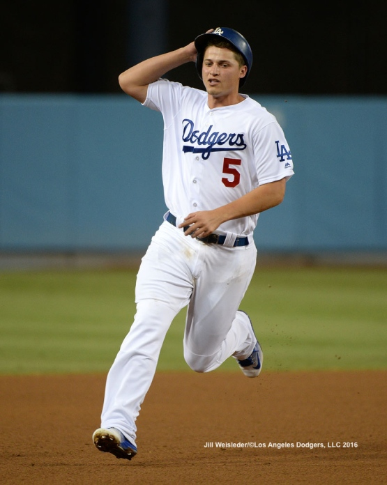 Corey Seager rounds to third base. Jill Weisleder/Dodgers