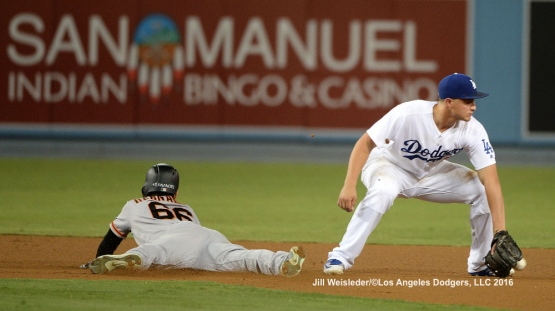San Francisco Giants' Gorkys Hernandez slides safely to second base as Corey Seager comes up short with the tag. Jill Weisleder/Dodgers