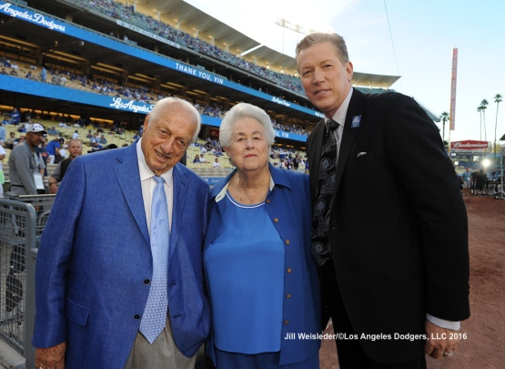 Tommy Lasorda, Roz Wyman and Orel Hershiser pose for a photo during pre-game ceremonies  honoring Vin Scully. Jill Weisleder/Dodgers