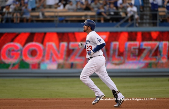 Adrian Gonzalez rounds the bases during after getting a home run. Jill Weisleder/Dodgers
