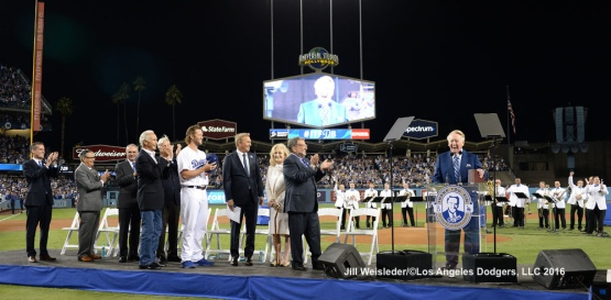 Vin Scully shares a laugh with the fans at Dodger Stadium. Jill Weisleder/Dodgers