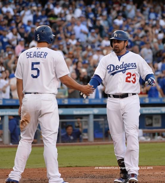 Corey Seager congratulates Adrian Gonzalez at home plate. Jill Weisleder/Dodgers
