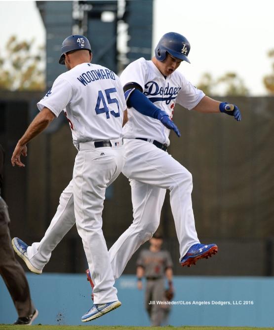 Third base coach Chris Woodward high-fives Joc Pederson after he connects for a home run. Jill Weisleder/Dodgers