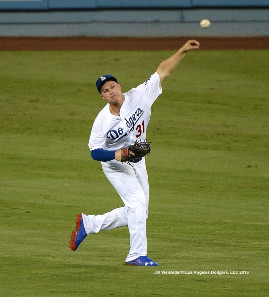 Joc Pederson makes the play and throws to first base. Jill Weisleder/Dodgers