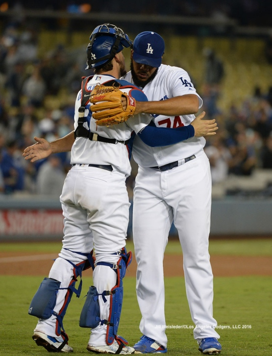 Yasmani Grandal and Kenley Jansen congratulate each other after the win against the Arizona Diamondbacks. Jill Weisleder/Dodgers