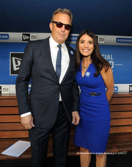 Actor Kevin Costner and Alana Rizzo pose for a photo in the dugout during pre-game festivities honoring Vin Scully. Jill Weisleder/Dodgers