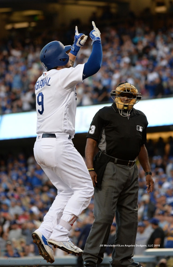 Yasmani Grandal points upwards to the sky after crossing home plate. Jill Weisleder/Dodgers