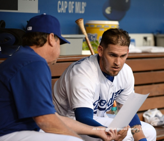 Pitching coach Rick Honeycutt and Yasmani Grandal discuss strategy during the game. Jill Weisleder/Dodgers