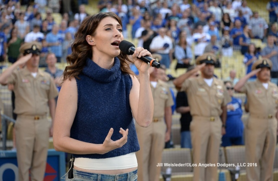 Singer Amy Renee Heidemann-Noonan from the pop group Karmin performs the national anthem prior to the start of the game. Jill Weisleder/Dodgers