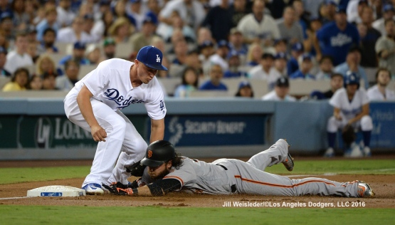 Corey Seager applies the tag to Brandon Crawford for the out at third base. Jill Weisleder/Dodgers