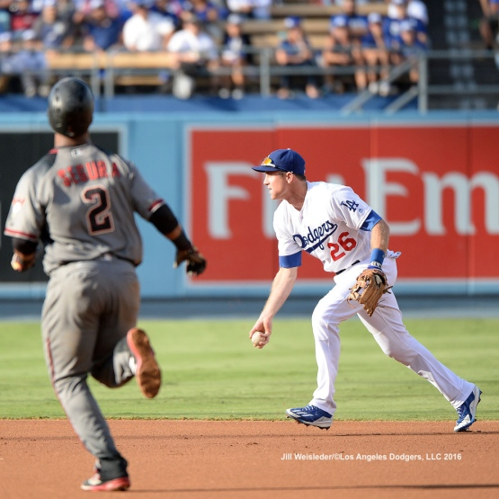 Chase Utely makes a play to second base to get out Jean Segura of the Arizona Diamondbacks. Jill Weisleder/Dodgers