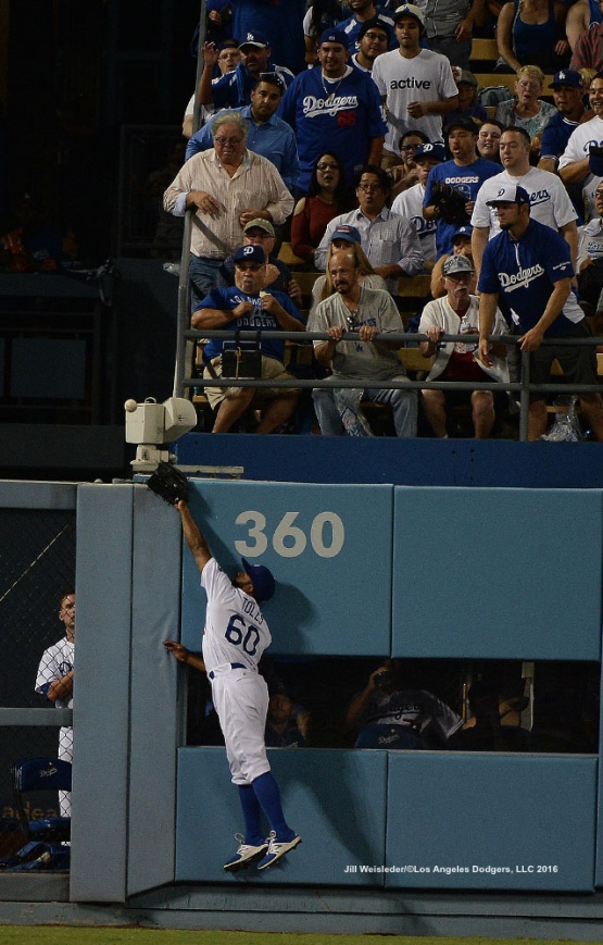 Andrew Toles attempts to make the catch but comes up short. Jill Weisleder/Dodgers