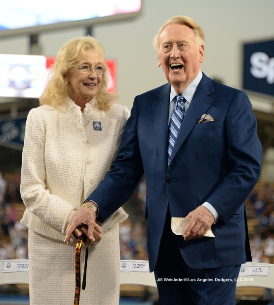 Sandra and Vin Scully smile as they are greeted on stage prior to the start of pre-game festivities. Jill Weisleder/Dodgers