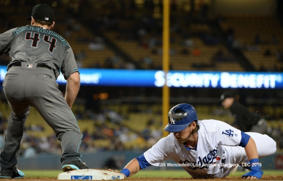 Josh Reddick slides safely back to first base. Jill Weisleder/Dodgers