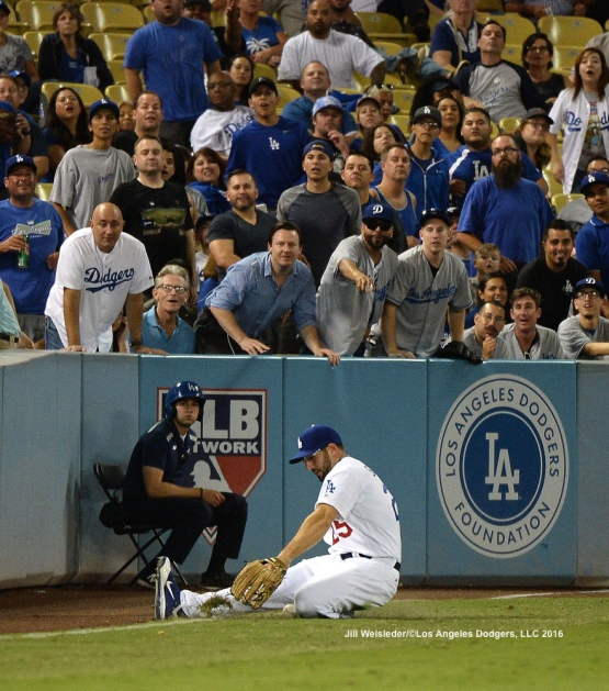 Rob Segedin slides across the foul line to make the attempt to stop the ball. Jill Weisleder/Dodgers