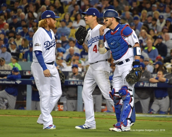 2016 NLCS Game 3---Justin Turner, Rich Hill and Yasmani Grandal-Los Angeles Dodgers vs Chicago Cubs Tuesday, October 18, 2016 at Dodger Stadium in Los Angeles, California. Photo by Jon SooHoo/© Los Angeles Dodgers, LLC 2016