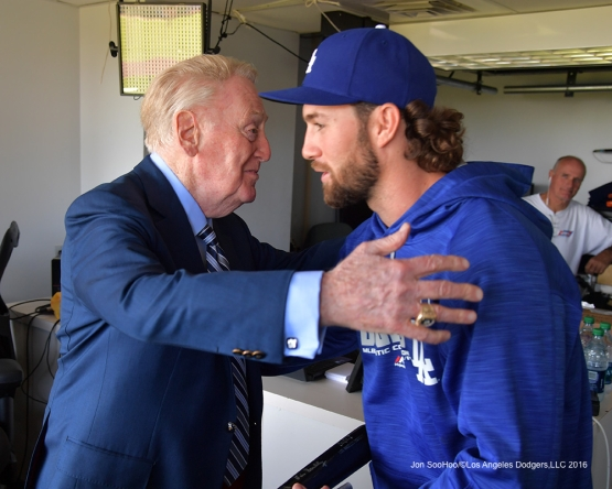 Vin Scully hugs Charlie Culberson prior to Los Angeles Dodgers game against the San Francisco Giants Saturday, October 1, 2016 at AT&T Park. Photo by Jon SooHoo/©Los Angeles Dodgers,LLC 2016