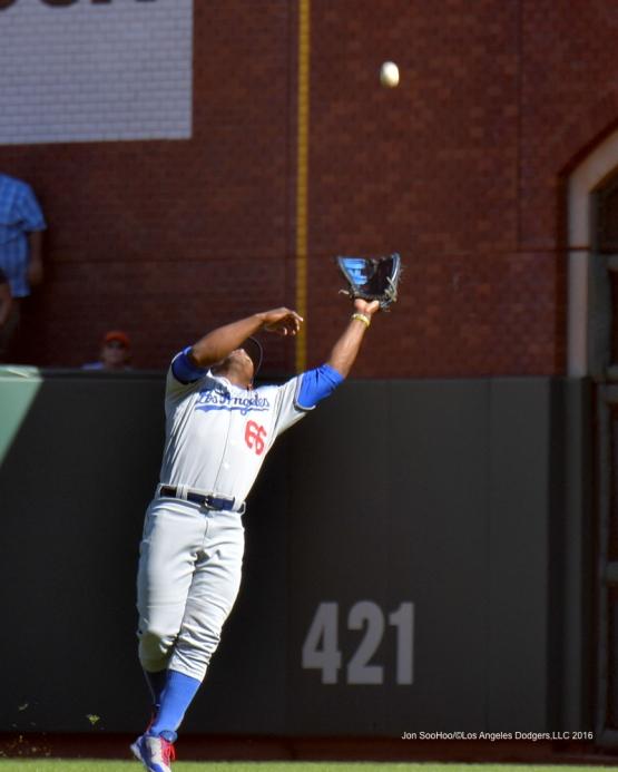 Yasiel Puig makes play against the San Francisco Giants Saturday, October 1, 2016 at AT&T Park. Photo by Jon SooHoo/©Los Angeles Dodgers,LLC 2016