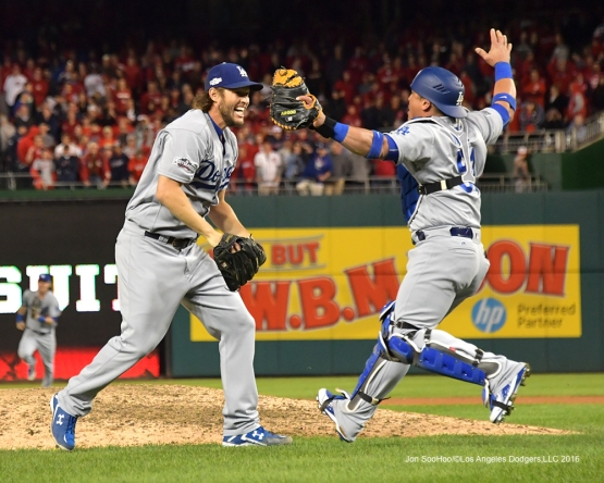 NLDS-Game 5-Clayton Kershaw celebrates Dodgers victory with Carlos Ruiz---Los Angeles Dodgers vs Washington Nationals-Dodgers defeat the Nationals 4-3. Wednesday, October 13, 2016. Photo by Jon SooHoo/©Los Angeles Dodgers,LLC 2016