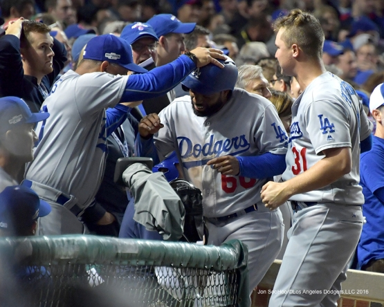 NLCS Game One-Andrew Toles is greeted by Dave Roberts-Los Angeles Dodgers vs Chicago Cubs  Saturday, October 15, 2016 at Wrigley Field in Chicago,Illinois. Photo by Jon SooHoo/©Los Angeles Dodgers,LLC 2016