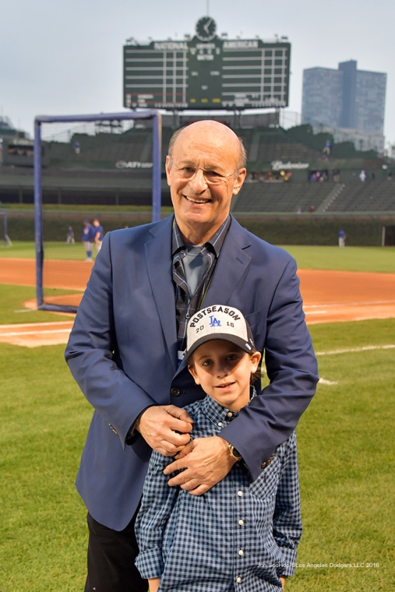 NLCS Game Two-Stan Kasten and grandson-Los Angeles Dodgers vs Chicago Cubs  Sunday, October 16, 2016 at Wrigley Field in Chicago,Illinois. Photo by Jon SooHoo/©Los Angeles Dodgers,LLC 2016