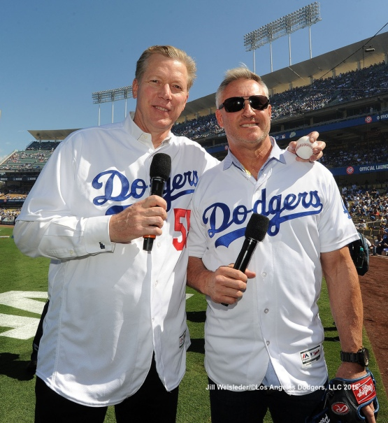 Former Dodgers Orel Hershiser and Steve Sax pose for a photo after the ceremonial first pitch during pre-game festivities. Jill Weisleder/Dodgers