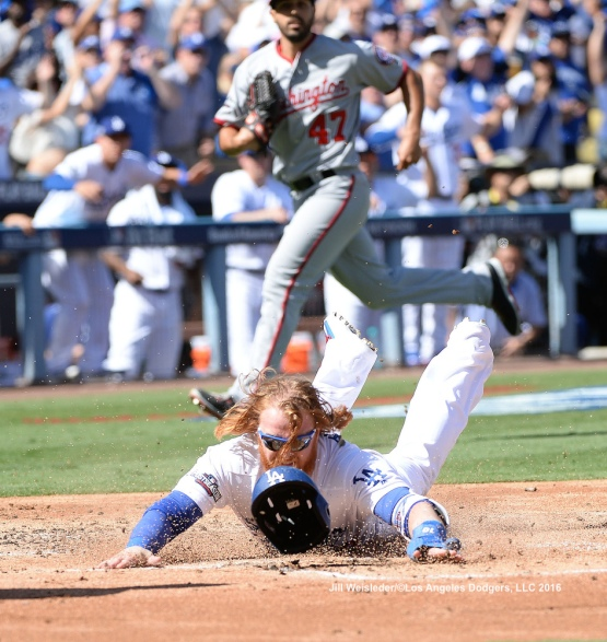 Justin Turner slides safely home on Corey Seager's double in the first inning. Jill Weisleder/Dodgers