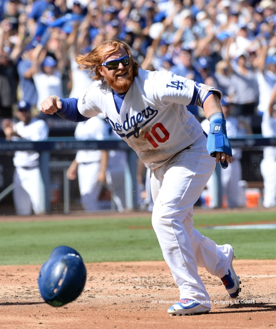Justin Turner reacts after scoring in a run. Jill Weisleder/Dodgers