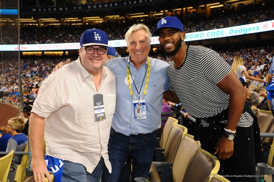 2016 NLCS Game 5---Eric Stonestreet, Mark Walter and Chris Paul-Chicago Cubs vs Los Angeles Dodgers Thursday, October 20, 2016 at Dodger Stadium in Los Angeles, California. Photo by Juan Ocampo/© Los Angeles Dodgers, LLC 2016