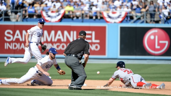 Charlie Culberson attempts to get the ball as Bryce Harper makes it safely to second base. Jill Weisleder/Dodgers