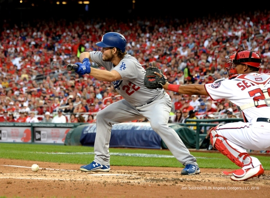 2016 NLDS Game One---Clayton Kershaw gets the bunt down-Los Angeles Dodgers vs Washington Nationals  Friday, October 7, 2016 at Nationals Park in Washington,DC.  Photo by Jon SooHoo/©Los Angeles Dodgers,LLC 2016