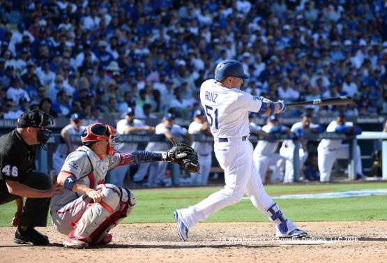 Carlos Ruiz connects fora home homerun. Jill Weisleder/Dodgers