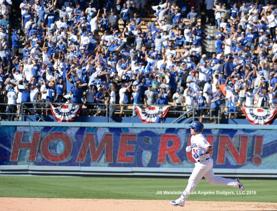 Carlos Ruiz rounds the bases after getting a home run. Jill Weisleder/Dodgers