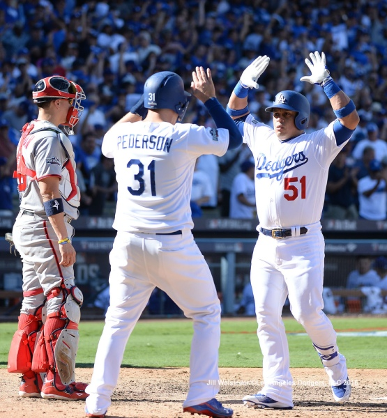 Joc Pederson and Carlos Ruiz high-five each other after coming in to score. Jill Weisleder/Dodgers