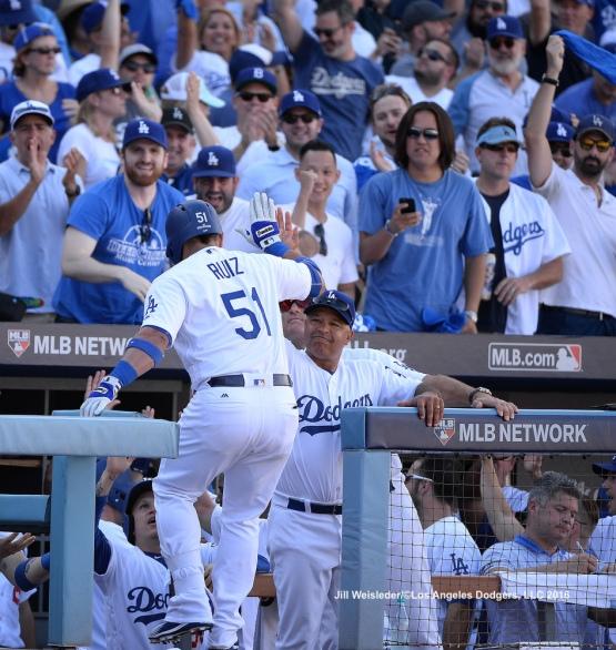 Dave Roberts congratulates Carlos Ruiz in the dugout. Jill Weisleder/Dodgers