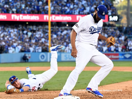 Kenley Jansen steps on first base, after getting the throw from Chase Utley, for the final out of the game.