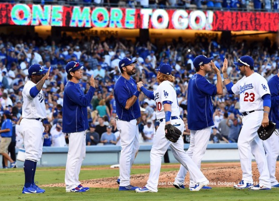 The Dodgers celebrate their 6-5 win over the Nationals to force a decisive Game 5.